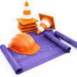 Traffic cones and hardhat with plans — Stock Photo