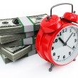 Clock and money stacks — Stock Photo