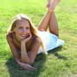 Girl on grass field — Foto de Stock