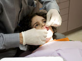 Dentist Works on an Hispanic Boy — Stockfoto
