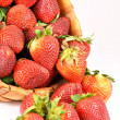 Fresh strawberries full of the basket - Stock Photo