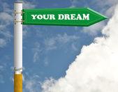 Your dream cigarette road sign — Stock Photo