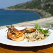 Dish with srimps and rice near mediterraneshore. — Stock Photo #5814859
