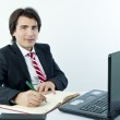 Young businessman taking notes — Stock Photo