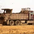 Truck spreading manure on a Saskatchewan stubble field — Stock Photo