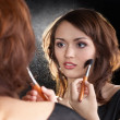 Stock Photo: Fashion model makeup with brush on mirror