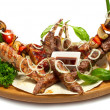 Set of roasted meat on the grill — Stock Photo
