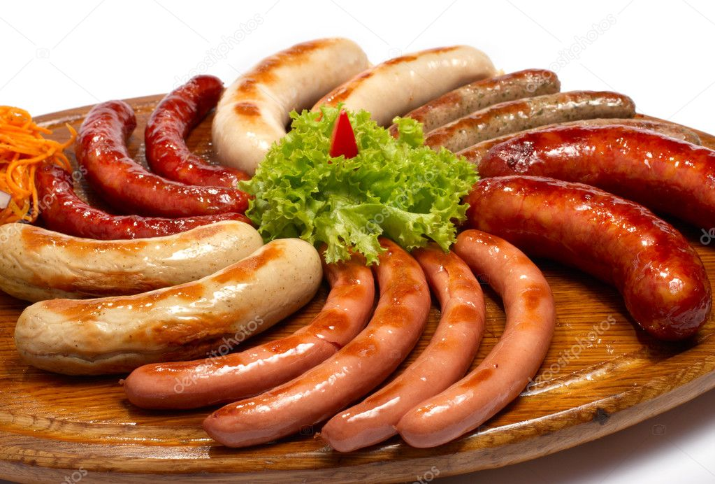 A set of different sausages, grilled on wooden plate  Stock Photo #6051526