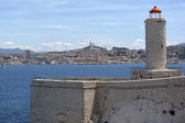 Lighthouse in front of Marseille city — Stock Photo