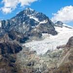 Alpine glacier melting in the Swiss Alps — Stock Photo #6569072