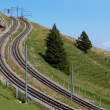 Two curved and steep railways in the mountains — Foto Stock