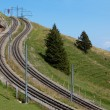 Two curved and steep railways in the mountains — Stok fotoğraf