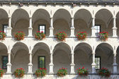 Old castle facade with arches and columns — Stock Photo