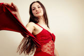 Sexy Girl Dancing in a Red Dress — Stock Photo