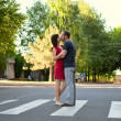 The loving couple kisses in the middle of street - Stock Photo