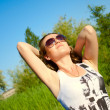 The nice girl rejoices to the sun — Stock Photo