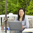 Stock Photo: Lady working at home on outdoor patio
