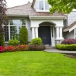 Green Front Yard and Flowers with Home - Stock Photo