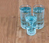 Crystal Blue Water on Bamboo Board — Stock Photo