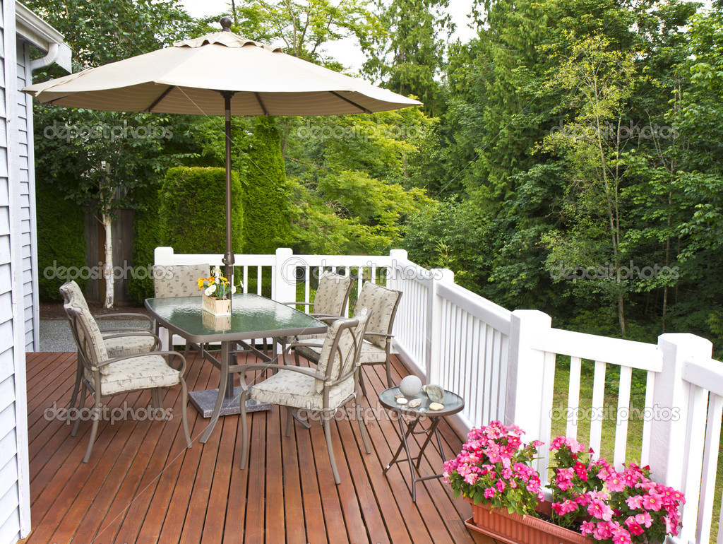 Outdoor patio setup on cedar wood deck  with trees in background  Stock Photo #6350533