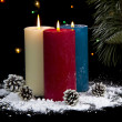 Snow Covered Candles at Night with cones — Stock Photo