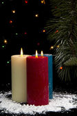 Snow Covered Candles at Night — Stock Photo