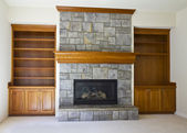 Open Fireplace and Book Shelf — Stock Photo