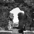 Black and white photograph of ruins of monastery - Stock Photo