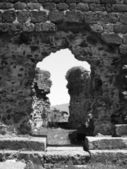 Black and white photograph of ruins of monastery — Stock Photo