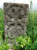 Old Cross stone in grass — Stock Photo