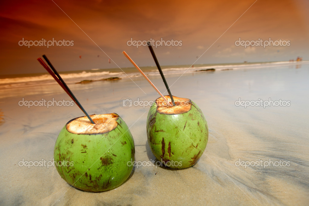 Coconut cocktail on beach sand — Stock Photo #5934025
