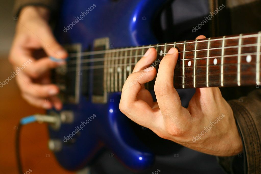 Man play solo on blue guitar — Stock Photo #5939958