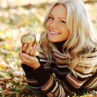 Woman with golden apple — Stock Photo
