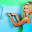 Woman paint on wall — Stock Photo