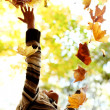 Woman drop leaves in autumn park — Stock Photo #6643274