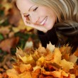 Royalty-Free Stock Photo: Woman portret in autumn leaf