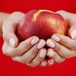 Peach in woman hands — Stock Photo