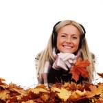 Autumn woman listening music — Stock Photo #6643414