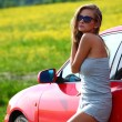 Woman in red car — Stock Photo #6649706
