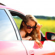 Woman in red car — Stock Photo #6649713