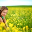 Woman on oilseed field — Stock Photo #6649966