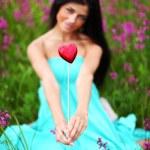 Woman on flower field — Stock Photo #6649976