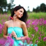 Woman on flower field — Stock Photo #6649981