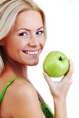 Woman eat green apple — Stock Photo