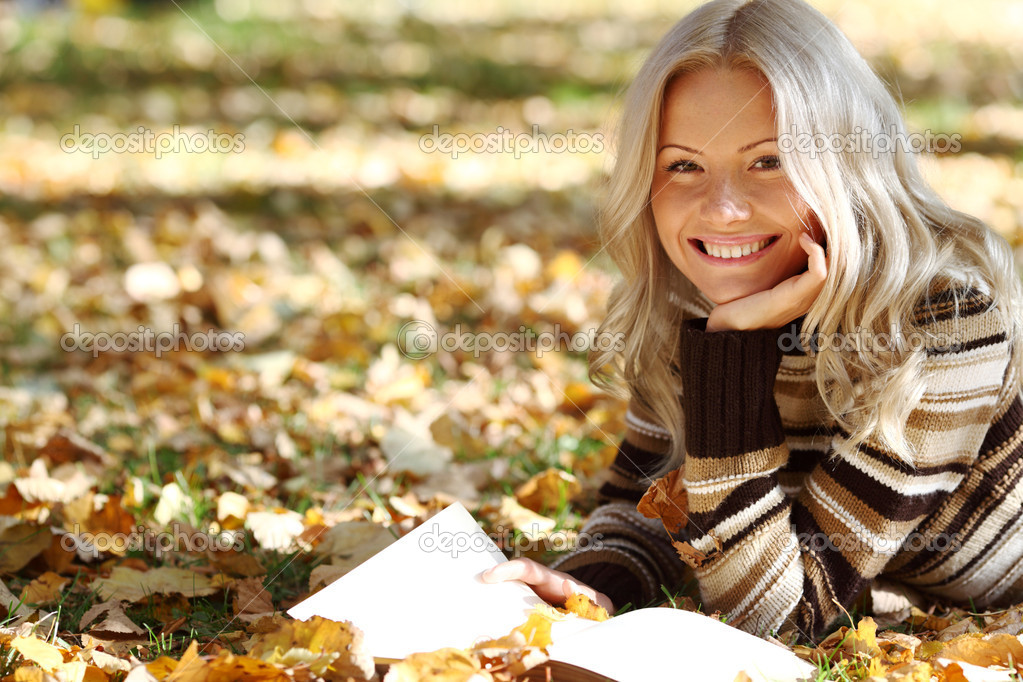 Woman read the book in autumn park  Stock Photo #6643099