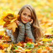 Woman portret in autumn leaf — Stock Photo #6650147