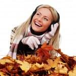 Autumn woman listening music — Stock Photo #6650371
