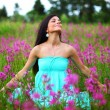 Woman on pink flower field — Stock Photo