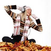 Autumn woman listening music — Stock Photo