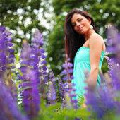 Woman on pink flower field — Stock Photo